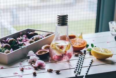 Clear Glass Light Bulb Pitcher with Sliced Lemon And Orange Fruits