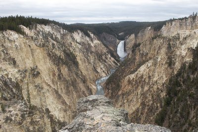 Cliff Top View Of River Valley And Waterfall