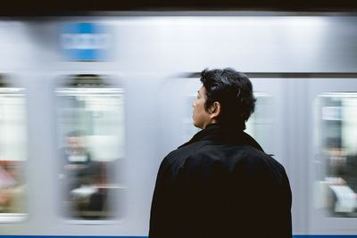 Close-Up Photography of Man Standing Front of Train