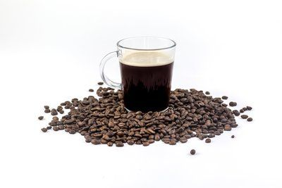 Coffee Beans And Cup Isolated