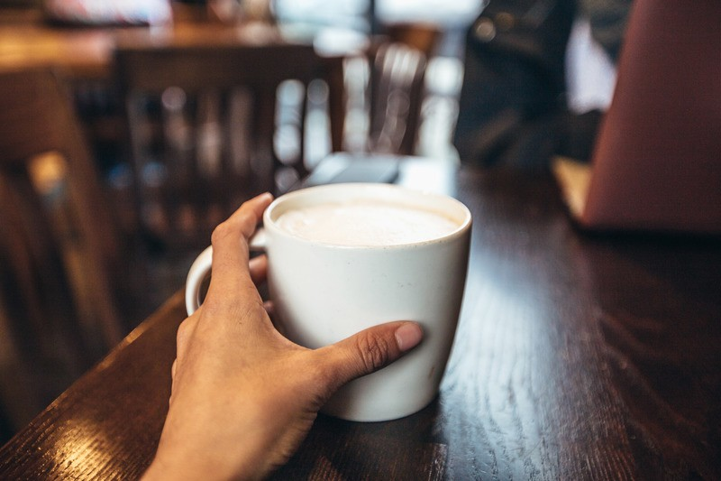 Coffee Cup in Hand