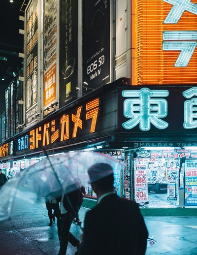 Commuters On The Streets Of Neon Tokyo