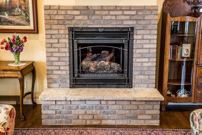 Cosy Exposed Brick Fireplace