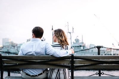 Couple Sitting on Bench Near Water