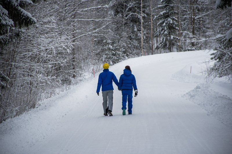 Couple Takes A Walk In Winter Countryside