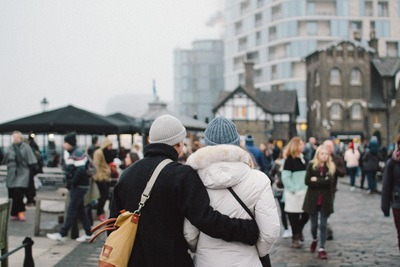 Couple Wearing Jacket And Knit Caps Walking on Road