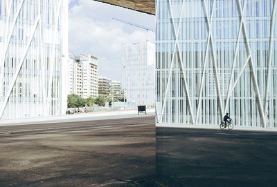 Cyclist By Modern Building