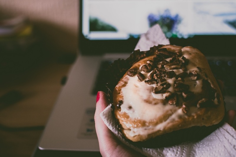 Eating Muffin on Laptop