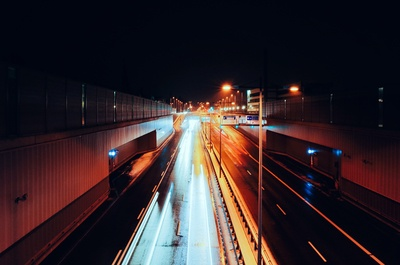 Empty Road with Streaks of Light at Nighttime Time Lapse