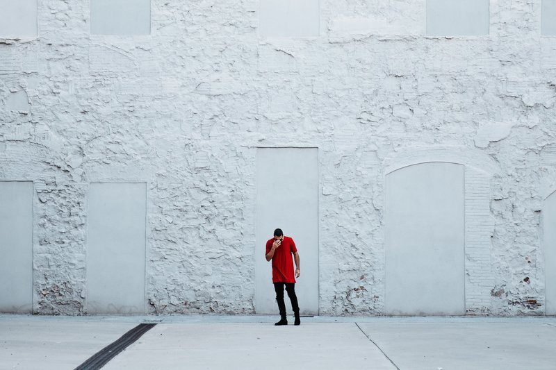 Fashionable Man By Textured Wall