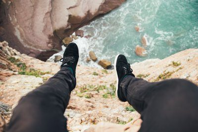 Feet Hanging Over Cliff