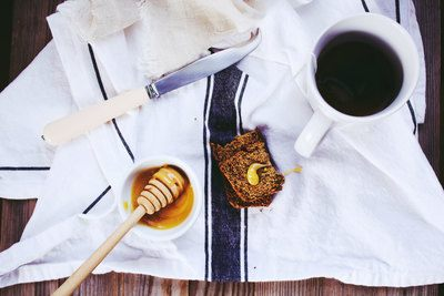 Flat Lay Photography of White Knife, Honey Dipper on Bowl, And