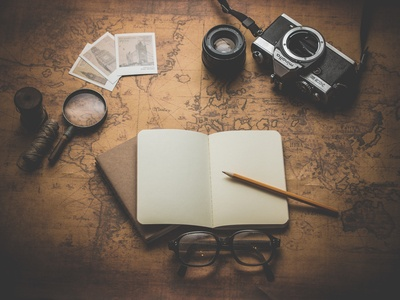 Flat Ray Photography of Book, Pencil, Camera, And with Lens