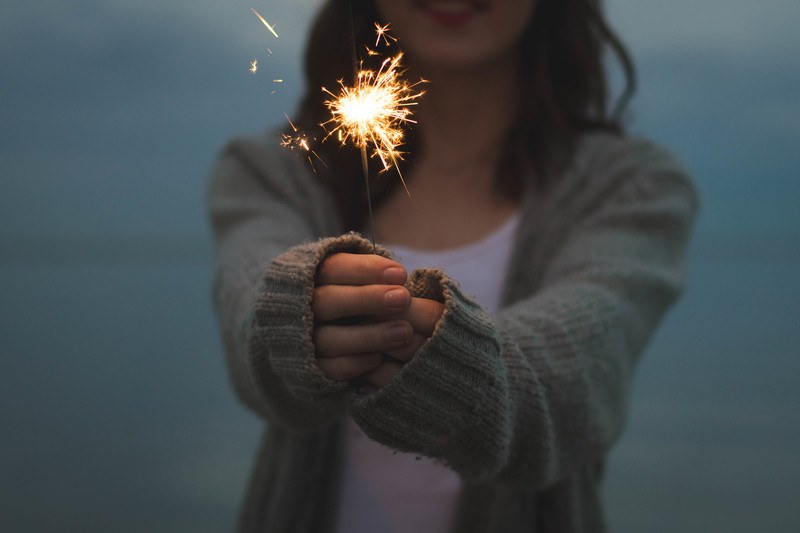 Focus  A Woman Holding Sparklers