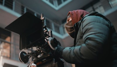 Focus Photography of Man in Black Jacket with Camera