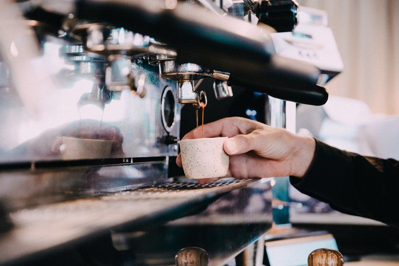 Fresh Double Espresso Being Made By Barista