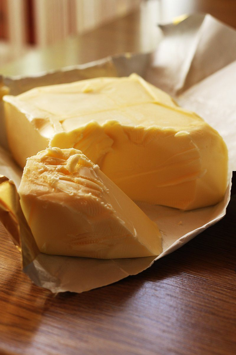 Fresh Unwrapped Butter In A Sunny Kitchen