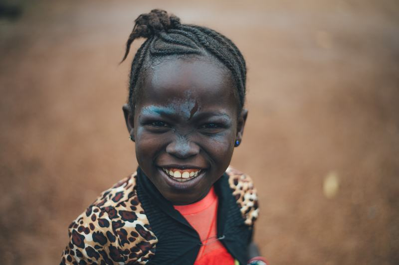Girl Smiling in Front of Camera