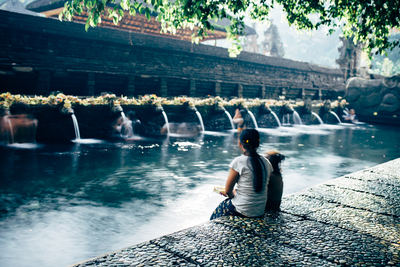 Girl Viewing Buddhist Temple