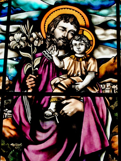Glass window with St. Joseph and the child Jesus