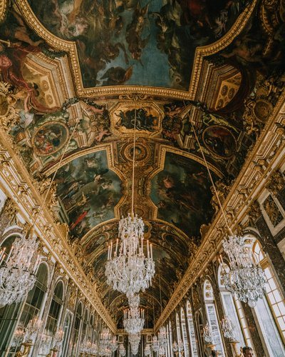 Gold-Trimmed Frescoes And Crystal Chandeliers