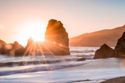 Golden Hour Photography of Rock Formation in Water
