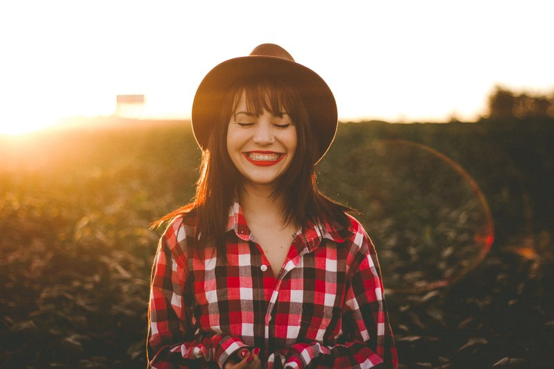 Golden Hour Photography of Woman in Red And White Checkered Dress