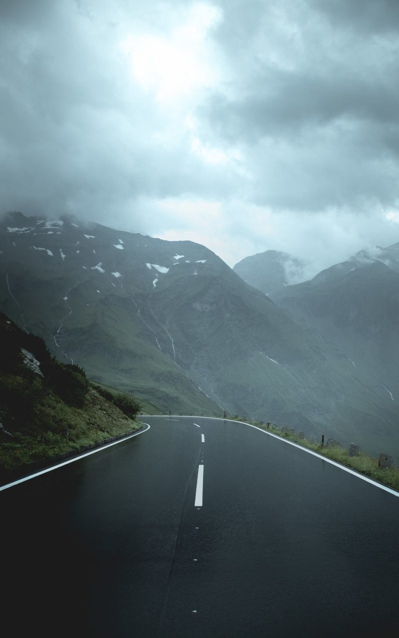 Gray Concrete Road Between Green Mountains