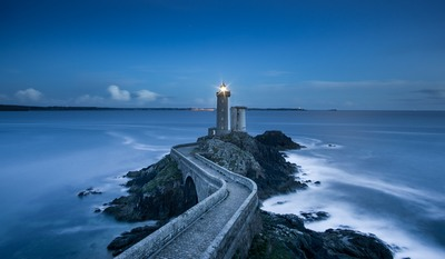 Gray Lighthouse on Islet with Concrete Pathway
