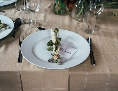 Green And White Decorative Flower on White Plate And Cutlery Set