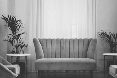 Grey Couch Near White Window Curtain