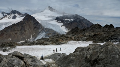Group of People Hiking on Snowy Mountains