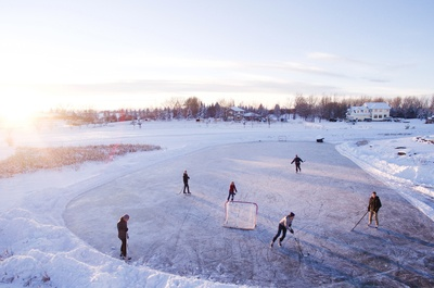 Group of People Playing Outdoor Hockey During Winter