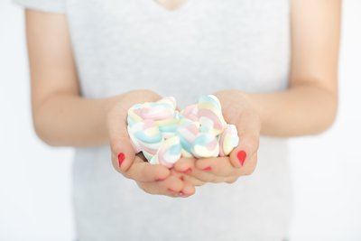 Hands Holding Marshmallow Candy