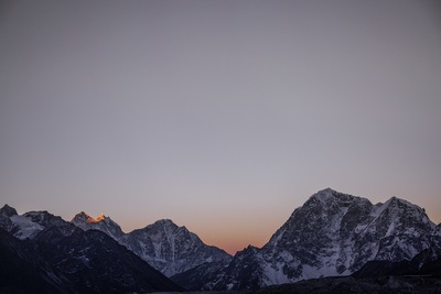 High Angle Landscape Photography of Snow Covered Mountain Ranges During Golden