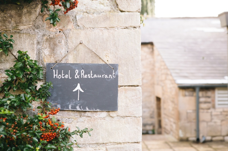 Hotel &Amp; Restaurant Signage Posted on Concrete Wall