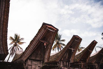 Indonesian Rooftops Below The Clouds
