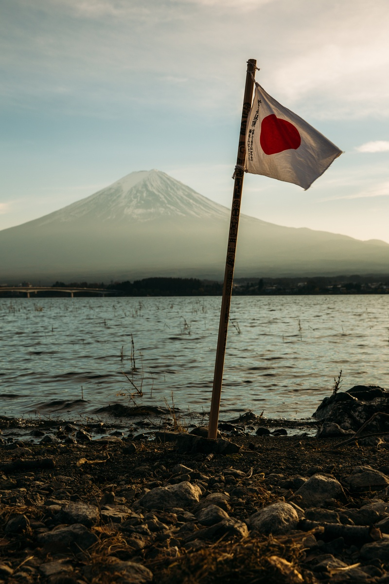 Japan Flag Mounted Near in Water