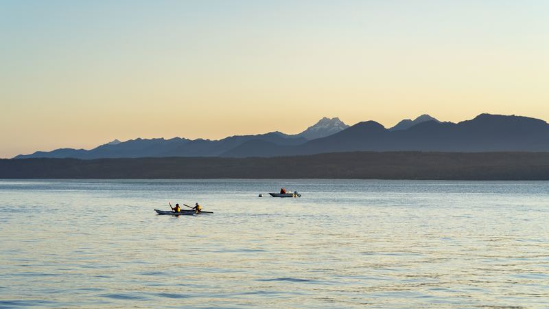 Kayakers And The Mountains