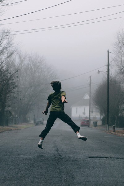 Kid Jumps in the Middle of the Road on A Foggy