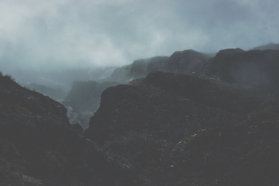 Landscape Photography of Mountains Covered in Fog