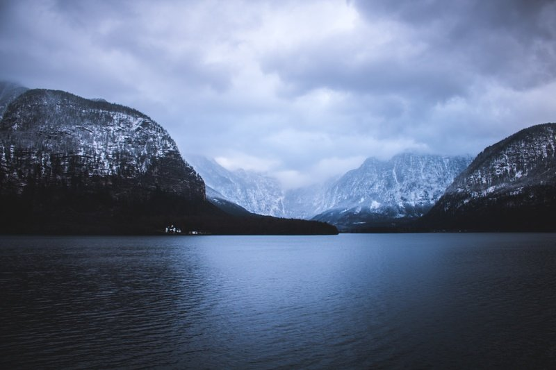 Landscape Photography of Mountains Near Water