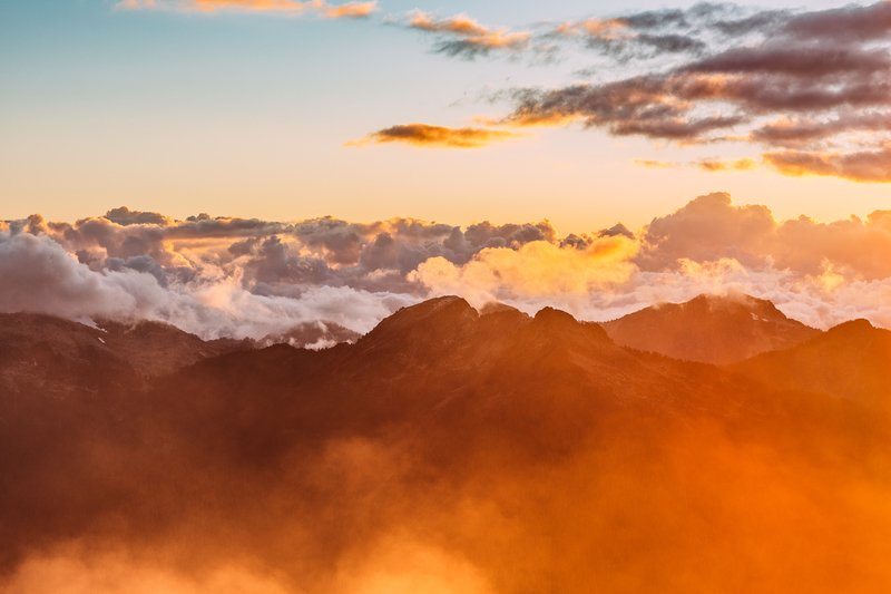Landscape Photography of Mountains with Cloudy Skies