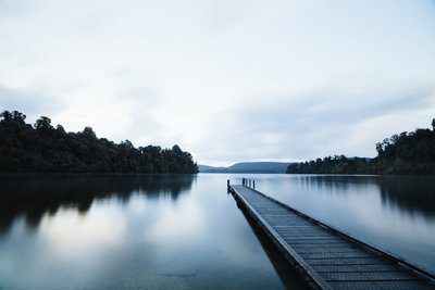 Long Dock Through Calm Lake