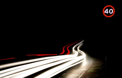 Long-Exposure Photography of Light Streaks on Road at Nighttime