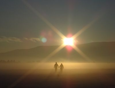 Man And Woman Holding Hands Walking on Mountain