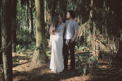 Man And Woman Standing Together Surrounded By Green Trees And Plants