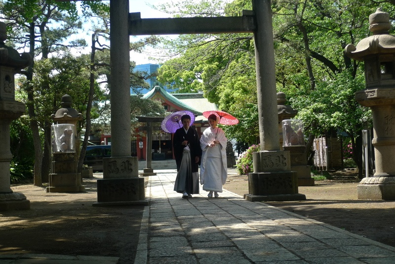 Man And Woman Standing Under Arch