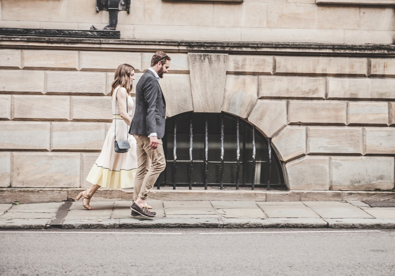 Man And Woman Walking Beside A Road