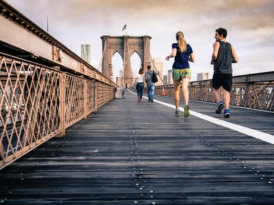 Man And Woman in Black Tops Jogging At Bridge Under Clear